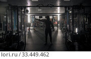 Купить «Silhouette of tough man training his hands using a simulator in the gym», видеоролик № 33449462, снято 9 июля 2020 г. (c) Константин Шишкин / Фотобанк Лори