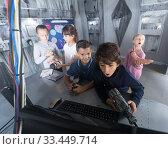 Купить «children look for a way out in quest room bunker», фото № 33449714, снято 21 октября 2017 г. (c) Яков Филимонов / Фотобанк Лори