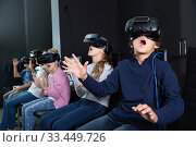 Купить «Enthusiastic children in virtual reality glasses in quest room», фото № 33449726, снято 21 октября 2017 г. (c) Яков Филимонов / Фотобанк Лори