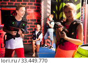 Teen kids during lasertag game. Стоковое фото, фотограф Яков Филимонов / Фотобанк Лори