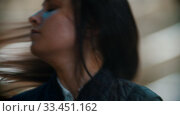 Купить «Hippodrome - Rider taking off her black helmet», видеоролик № 33451162, снято 4 июня 2020 г. (c) Константин Шишкин / Фотобанк Лори