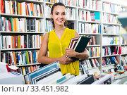 Young glad woman reader holding books. Стоковое фото, фотограф Яков Филимонов / Фотобанк Лори