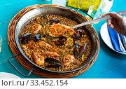 Купить «Paella in frying pan», фото № 33452154, снято 9 апреля 2020 г. (c) Яков Филимонов / Фотобанк Лори