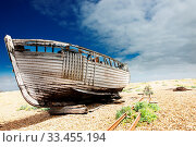 Купить «Color image of an old wooden fishing boat left to rot and decay on the shingle beach at Dungeness, England, UK.», фото № 33455194, снято 5 апреля 2020 г. (c) age Fotostock / Фотобанк Лори