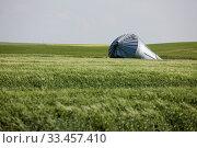 Купить «Metal Grain Bin Damaged tornado bent Canada», фото № 33457410, снято 27 мая 2020 г. (c) age Fotostock / Фотобанк Лори