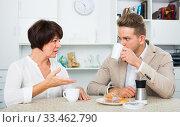woman and man drinking tea with cakes. Стоковое фото, фотограф Яков Филимонов / Фотобанк Лори