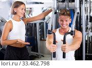 Купить «Man using pec deck gym machinery», фото № 33462798, снято 8 июля 2020 г. (c) Яков Филимонов / Фотобанк Лори