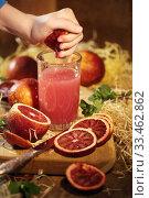 Купить «Детские руки выжимают сок из апельсина», фото № 33462862, снято 30 марта 2020 г. (c) Марина Володько / Фотобанк Лори
