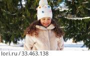 Купить «happy little girl throwing snow in winter park», видеоролик № 33463138, снято 9 марта 2020 г. (c) Syda Productions / Фотобанк Лори