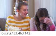 Купить «teenage girls eating popcorn at home», видеоролик № 33463142, снято 6 марта 2020 г. (c) Syda Productions / Фотобанк Лори