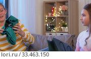 Купить «happy teenage girls with shopping bags at home», видеоролик № 33463150, снято 6 марта 2020 г. (c) Syda Productions / Фотобанк Лори