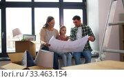 Купить «happy family with blueprint moving to new home», видеоролик № 33463154, снято 22 марта 2020 г. (c) Syda Productions / Фотобанк Лори
