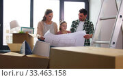Купить «happy family with blueprint moving to new home», видеоролик № 33463158, снято 22 марта 2020 г. (c) Syda Productions / Фотобанк Лори