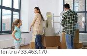 Купить «happy family with child moving to new home», видеоролик № 33463170, снято 22 марта 2020 г. (c) Syda Productions / Фотобанк Лори