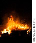 Купить «Burning fire flame on wooden house roof», фото № 33468614, снято 18 марта 2018 г. (c) Илья Андриянов / Фотобанк Лори