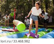 Купить «Funny adult friends are jumping on an inflatable trampoline», фото № 33468982, снято 2 апреля 2020 г. (c) Яков Филимонов / Фотобанк Лори