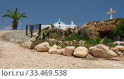 Купить «The Ayia Thekla Chapel on the rocky seashore above the sea. Ayia Napa. Cyprus», видеоролик № 33469538, снято 31 марта 2020 г. (c) Serg Zastavkin / Фотобанк Лори