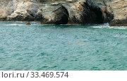 The caves of the elevated rocky shore of Cape Greco. Cyprus. Стоковое видео, видеограф Serg Zastavkin / Фотобанк Лори
