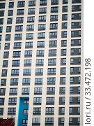 Купить «Residental Building on Sky Background, Apartment Building Exterior, Apartment Complex with Windows, Building Face, Highrise Buildings, Square Background, Urban Housing», фото № 33472198, снято 10 июля 2020 г. (c) age Fotostock / Фотобанк Лори