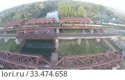 Купить «Вид с воздуха. Железнодорожный мост. Река, Россия, Уфа», видеоролик № 33474658, снято 23 февраля 2012 г. (c) Mikhail Erguine / Фотобанк Лори