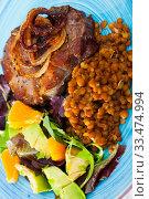 Купить «Tasty cooked fried pork with lentils, avocado and orange at plate», фото № 33474994, снято 10 июля 2020 г. (c) Яков Филимонов / Фотобанк Лори