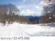 Купить «Beautiful mountains covered with snow. Sunny day and blue sky on a frosty day», фото № 33475086, снято 5 марта 2019 г. (c) Олег Хархан / Фотобанк Лори