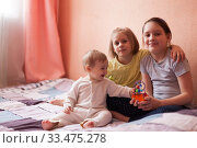 Three girls of eight, seven and one-year-old. Стоковое фото, фотограф Дарья Филимонова / Фотобанк Лори