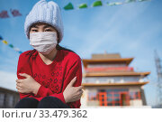 Купить «asian portrait wearing mask temple public place», фото № 33479362, снято 23 марта 2020 г. (c) Mark Agnor / Фотобанк Лори