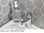 close up of water tap with liquid soap on sink. Стоковое фото, фотограф Syda Productions / Фотобанк Лори