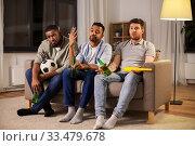 Купить «sad friends with ball and vuvuzela watching soccer», фото № 33479678, снято 28 декабря 2019 г. (c) Syda Productions / Фотобанк Лори