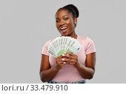 Купить «happy african american woman with euro money», фото № 33479910, снято 26 января 2020 г. (c) Syda Productions / Фотобанк Лори