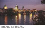Купить «Night view of Charles bridge. Prague. Czech Republic», видеоролик № 33480450, снято 10 апреля 2020 г. (c) Яков Филимонов / Фотобанк Лори