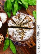 Купить «Pie with sorrel and icing sugar», фото № 33486370, снято 22 мая 2019 г. (c) Надежда Мишкова / Фотобанк Лори