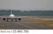 Купить «Boeing 777 towing from service», видеоролик № 33486786, снято 20 июля 2017 г. (c) Игорь Жоров / Фотобанк Лори