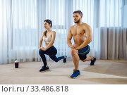 Morning fit workout of love couple at home. Стоковое фото, фотограф Tryapitsyn Sergiy / Фотобанк Лори