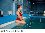 Купить «Female swimmer in red swimsuit at the poolside», фото № 33486886, снято 19 февраля 2020 г. (c) Tryapitsyn Sergiy / Фотобанк Лори