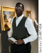 Купить «Positive african man in museum», фото № 33487434, снято 19 января 2019 г. (c) Яков Филимонов / Фотобанк Лори