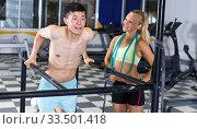 Купить «Man doing push-ups with trainer», фото № 33501418, снято 16 июля 2018 г. (c) Яков Филимонов / Фотобанк Лори