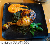 Купить «Chicken thigh with couscous with black curry, jalapenos and romesco», фото № 33501666, снято 6 июня 2020 г. (c) Яков Филимонов / Фотобанк Лори