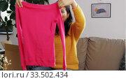 Купить «happy asian young woman with parcel box at home», видеоролик № 33502434, снято 26 марта 2020 г. (c) Syda Productions / Фотобанк Лори