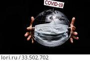 Купить «Hands holding globe sphere where shown white board COVID-19», фото № 33502702, снято 13 марта 2020 г. (c) Alexander Tihonovs / Фотобанк Лори