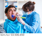 Купить «Patient afraid of dentist during doctor visit», фото № 33506650, снято 8 марта 2018 г. (c) Elnur / Фотобанк Лори