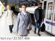 Купить «Woman is standing on platform and waiting train», фото № 33507466, снято 3 июля 2020 г. (c) Яков Филимонов / Фотобанк Лори