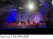 Купить «Musical instruments of symphonic orchestra and music stands for music on the concert stage», фото № 33509054, снято 8 декабря 2019 г. (c) Евгений Ткачёв / Фотобанк Лори
