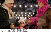 Купить «happy family eating pancakes on skating rink», видеоролик № 33509322, снято 22 марта 2020 г. (c) Syda Productions / Фотобанк Лори