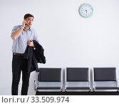 Купить «Man nervously impatiently waiting in the lobby», фото № 33509974, снято 18 января 2018 г. (c) Elnur / Фотобанк Лори