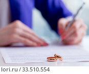 Woman signing prenuptial agreement in court. Стоковое фото, фотограф Elnur / Фотобанк Лори