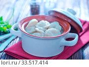 Купить «Boiled pelmeni in bowl and on a table», фото № 33517414, снято 9 апреля 2020 г. (c) age Fotostock / Фотобанк Лори