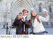 Купить «Cheerful man and woman making selfie», фото № 33517662, снято 18 ноября 2017 г. (c) Яков Филимонов / Фотобанк Лори