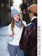 Купить «Portrait of adult couple talking at the city», фото № 33517670, снято 18 ноября 2017 г. (c) Яков Филимонов / Фотобанк Лори